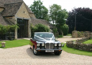 Daimler DS420 Limousine wedding car at The Great Tythe Barn, Tetbury