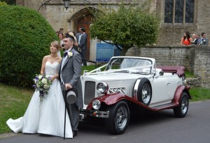 Natasha and Dean with their wedding car at purton church