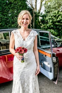 Ellie arriving for her wedding at Abbey House Gardens near Malmesbury
