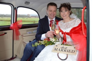 Melanie and Mark in the Fairway wedding car