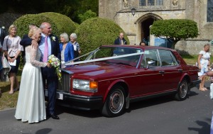 Laurie and Gordon with their Wedding Car