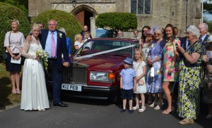 The wedding party around the Rolls Royce