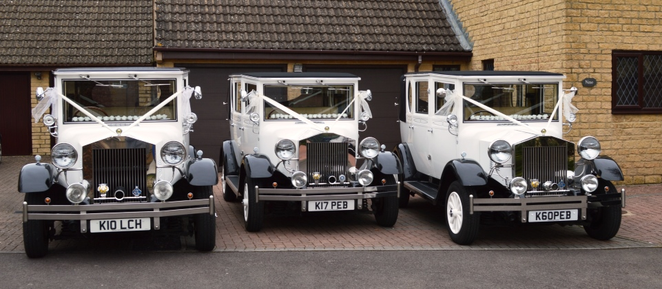 Three matching Imperial wedding cars