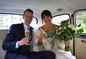 Sophie & George in Fairway weddong car at Bibury Church